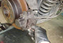 Rear Brake Pads If the brake pad spring has not come out already remove the brake pad spring by unhooking it from the bottom brake pad retaining pin.