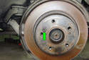 ThisPicture illustrates the left side rear rotor with the brake caliper already removed.