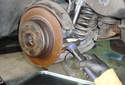 If the brake rotor is seized on the hub flange you can tap it off with a hammer.