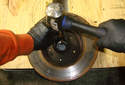 If you are replacing the wheel bearing you need to tap out the bearing races from the hub.
