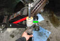 Make sure you install the new or used bump stop (green arrow) on the new shock absorber before installation.