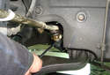 Use a splitting fork to separate the tie rod from the center link.