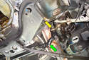 This Picture illustrates under the left side of the car where the center link (green arrow) meets the Pitman Arm.