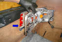 Remove the tail light mounting frame from the car by moving it in the direction of the blue arrow.