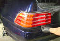 Pull the tail light lens out of the body of the car.