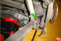 Use a pry bar (green arrow) to lever the rear forward lower link lower mount sleeve out of the spindle.