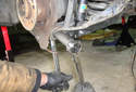 Remove the 22mm fastener for the lower control arm to spindle mount.