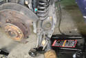Remove the lower control arm from the car.