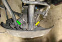 This Picture illustrates looking down at the spindle in the left rear wheel well.