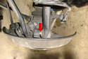 Tap with a hammer or lever the link out of the spindle mount.