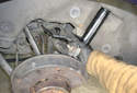 With both ends of the rear rearward upper link disconnected remove it from the car.