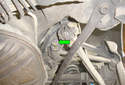 Pull the fastener (green arrow) out of the inner toe adjustment link sub frame mount.