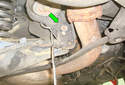 Unplug the electrical connection to the hydraulic roll bar sensor by pressing the wire retainer (green arrow) and pulling the connector straight off the sensor.