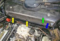 Unclip the three clips (green and yellow arrows) on the front of the cabin air filter housing by moving them in the direction of the blue arrow.