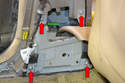 Use a T30 Torx and remove the four bolts holding the two piece lower bracket (red arrows).