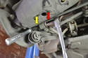 Begin by remove the nut attaching the sway bar to the drop link.