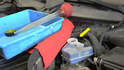 Keep your eye on the fluid level in the master cylinder reservoir (yellow arrow) it can overflow when you push back on the pistons.