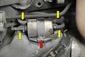You will begin by removing the T25 Torx screw holding the filter in place (red arrow).