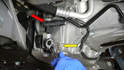 There is an oxygen sensor (red arrow) holder attached to the oil pan right above the drain plug, it is best to move it out of the way first.