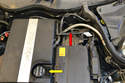 Move to the engine compartment where you will find the oil filter housing as well as the oil filler cap.