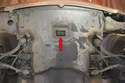 This photo shows the lifting point or pad in the center of the engine tray (red arrow).