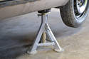 Once you reach the desired height, install a jack stand at each jack pad location to support the vehicle.
