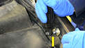 With the clip moved away from the shock housing you can push the shock off the mounting ball (yellow arrow).