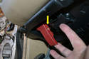 Working below the dash you will need to remove the parking brake cable from the parking brake handle.