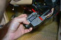 11: Remove the cable from the top of the unit by compressing the two tabs on the top and pulling it out.
