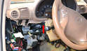 The lower dash is now only held in by two clips, one on each side of the steering column (red arrow, one shown).