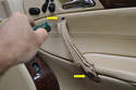 With the handle off use your T27 Torx and remove the 2 screws inside the handle (yellow arrows) securing it to the door.