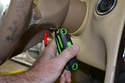 There are two access holes for the T30 Torx screws that hold the airbag to the steering wheel.