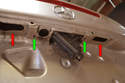 With the fascia off you remove two T27 Torx bolts (green arrows already removed) holding in the lift handle and key assembly.