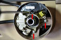 Remove the three T20 Torx screws (red arrows) that hold the stalks and steering column cover to the steering column.