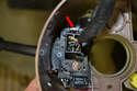 To remove the multi pin connector, squeeze down on the tab (red arrow) and pull the connector from the stalk.