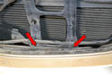 There are two 10mm bolts holding the center bracket to the front of the car from the back of the bracket (red arrows, not shown).