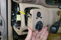 Compress the clip and push the unit forward (yellow arrow) until it releases from the dash.