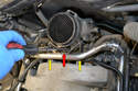 Use a flat head screw driver and release the clip (red arrow) that holds the sensor housing to the intake manifold (yellow arrows).