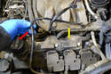 You will need to move the small vacuum hose (red arrow) out of the way: it just unclips from the wiring harness holder.