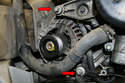 The alternator is held to the engine by two bolts (red arrows).