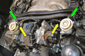 Remove the two rubber hoses connecting the vacuum regulators.