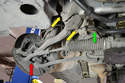 This photo illustrates where the upper control arm connects to the steering knuckle (red arrow), the chassis (yellow arrows) and the sway bar bracket (green arrow) that will need to be removed to get to the chassis bolt.