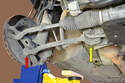 To remove the lower control arm you must follow the same steps as removing the upper.