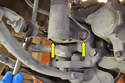 There are two 21mm bolts (yellow arrows) holding the strut to the lower part of the steering knuckle.