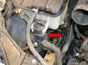 The auxiliary coolant pump is located on the front of the coolant tank.