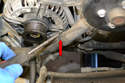 Move to the two hoses that connect to the lower part of the coolant pump.