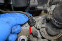 Remove the electrical connection (red arrow) for the coolant temperature sensor as you do not damage it while removing the pump.