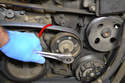 Locate the tensioner and using the Torx driver turn it counter-clockwise 45 degrees.