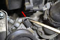 Use a flathead screw driver and slide the clip (red arrow) that holds the sensor in place up towards the air pump, you will not be able to pull the clip all the way straight up and out with out removing the air pump.