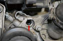The old gasket (red arrow) may stay in the engine; make sure you remove it before installing the new sensor.